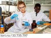 Купить «Young woman scientist working in research laboratory performing experiments», фото № 33735797, снято 21 марта 2019 г. (c) Яков Филимонов / Фотобанк Лори