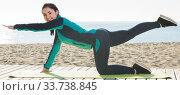 Купить «Energetic young girl training yoga poses», фото № 33738845, снято 10 апреля 2017 г. (c) Яков Филимонов / Фотобанк Лори