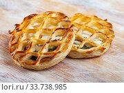 Купить «Puffs with goat cheese and spinach on wooden background», фото № 33738985, снято 27 мая 2020 г. (c) Яков Филимонов / Фотобанк Лори
