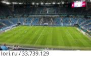 Купить «Футбольный стадион с игроками на поле, размыто», видеоролик № 33739129, снято 19 марта 2020 г. (c) Кекяляйнен Андрей / Фотобанк Лори