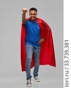 indian man in superhero cape makes winning gesture. Стоковое фото, фотограф Syda Productions / Фотобанк Лори