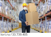 Купить «worker in respirator mask with boxes at warehouse», фото № 33739405, снято 7 марта 2015 г. (c) Syda Productions / Фотобанк Лори
