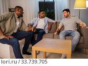 Купить «happy male friends talking at home at night», фото № 33739705, снято 28 декабря 2019 г. (c) Syda Productions / Фотобанк Лори