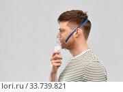 unhealthy young man wearing oxygen mask. Стоковое фото, фотограф Syda Productions / Фотобанк Лори