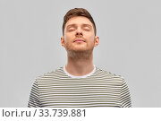 happy young man in striped t-shirt breathing. Стоковое фото, фотограф Syda Productions / Фотобанк Лори