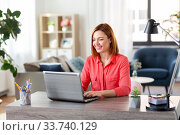 happy woman with laptop working at home office. Стоковое фото, фотограф Syda Productions / Фотобанк Лори