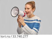 Купить «teenage girl speaking to megaphone», фото № 33740277, снято 26 февраля 2020 г. (c) Syda Productions / Фотобанк Лори