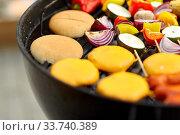 Купить «barbecue kebab meat and vegetables on grill», фото № 33740389, снято 19 сентября 2019 г. (c) Syda Productions / Фотобанк Лори