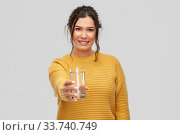Купить «smiling young woman with water in glass», фото № 33740749, снято 20 марта 2020 г. (c) Syda Productions / Фотобанк Лори