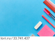 pink sticky notes, pens, pencils, clips and eraser. Стоковое фото, фотограф Syda Productions / Фотобанк Лори