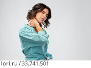 Купить «young woman in shirt suffering from neck ache», фото № 33741501, снято 18 апреля 2020 г. (c) Syda Productions / Фотобанк Лори