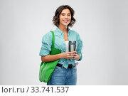 Купить «woman with bag for food shopping and tumbler», фото № 33741537, снято 18 апреля 2020 г. (c) Syda Productions / Фотобанк Лори