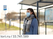 Купить «young woman wearing medical mask at bus stop», фото № 33741589, снято 8 апреля 2020 г. (c) Syda Productions / Фотобанк Лори