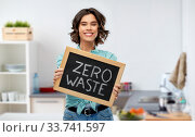 Купить «happy woman with chalkboard with zero waste words», фото № 33741597, снято 18 апреля 2020 г. (c) Syda Productions / Фотобанк Лори
