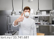 male chef with in respirator at restaurant kitchen. Стоковое фото, фотограф Syda Productions / Фотобанк Лори