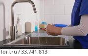 Купить «doctor or nurse washing hands with liquid soap», видеоролик № 33741813, снято 6 апреля 2020 г. (c) Syda Productions / Фотобанк Лори