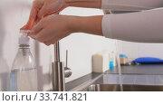 Купить «doctor or nurse washing hands with liquid soap», видеоролик № 33741821, снято 6 апреля 2020 г. (c) Syda Productions / Фотобанк Лори