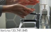 Купить «close up of woman washing hands with liquid soap», видеоролик № 33741845, снято 4 апреля 2020 г. (c) Syda Productions / Фотобанк Лори