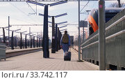 Купить «woman with bag walking along railway station», видеоролик № 33742117, снято 16 апреля 2020 г. (c) Syda Productions / Фотобанк Лори