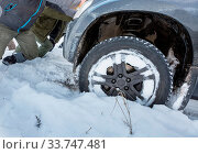 Купить «Car got stuck in winter seaon», фото № 33747481, снято 27 мая 2020 г. (c) easy Fotostock / Фотобанк Лори