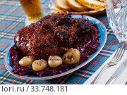 Baked pork knuckle with braised cabbage. Стоковое фото, фотограф Яков Филимонов / Фотобанк Лори
