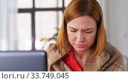 sick woman having video call on laptop at home. Стоковое видео, видеограф Syda Productions / Фотобанк Лори