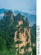 Vertical view of the stone pillars of Tianzi mountains in Zhangjiajie National park which is a famous tourist attraction, Wulingyuan, Hunan Province, China. Стоковое фото, фотограф Zoonar.com/Pawel Opaska / easy Fotostock / Фотобанк Лори