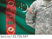 Купить «American soldier with flag on background - Turkmenistan», фото № 33755597, снято 13 июля 2020 г. (c) age Fotostock / Фотобанк Лори
