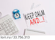 Купить «Writing note showing Keep Calm And. Business concept for motivational poster produced by British government Blank paper with copy space on the table with clock and pc keyboard», фото № 33756313, снято 28 мая 2020 г. (c) easy Fotostock / Фотобанк Лори