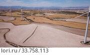 Купить «Top view of large wind power plants on field», видеоролик № 33758113, снято 2 июня 2020 г. (c) Яков Филимонов / Фотобанк Лори