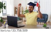 Купить «happy indian student with diploma at home», видеоролик № 33758509, снято 26 апреля 2020 г. (c) Syda Productions / Фотобанк Лори