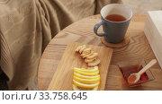 Купить «cup of tea, lemon, honey and ginger at home», видеоролик № 33758645, снято 26 апреля 2020 г. (c) Syda Productions / Фотобанк Лори