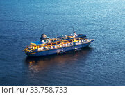 Купить «Cruise ship Celestyal Cruises a Cypriot tourist company parked near the Greek island of Santorini at night», фото № 33758733, снято 8 июня 2017 г. (c) Наталья Волкова / Фотобанк Лори