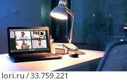 Купить «group video chat windows on laptop at night office», видеоролик № 33759221, снято 3 июля 2020 г. (c) Syda Productions / Фотобанк Лори
