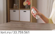 Купить «close up of woman cleaning table at home», видеоролик № 33759561, снято 10 мая 2020 г. (c) Syda Productions / Фотобанк Лори