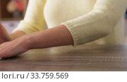 Купить «close up of woman cleaning table at home», видеоролик № 33759569, снято 10 мая 2020 г. (c) Syda Productions / Фотобанк Лори