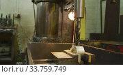 Купить «Caucasian male hands factory worker at a factory standing at a workbench and operating a bench drill», видеоролик № 33759749, снято 23 ноября 2019 г. (c) Wavebreak Media / Фотобанк Лори