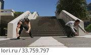 Купить «Caucasian men practicing parkour», видеоролик № 33759797, снято 31 октября 2019 г. (c) Wavebreak Media / Фотобанк Лори