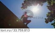 Купить «Caucasian man practicing parkour», видеоролик № 33759813, снято 31 октября 2019 г. (c) Wavebreak Media / Фотобанк Лори