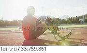 Купить «Disabled mixed race man with prosthetic legs sitting on racing track», видеоролик № 33759861, снято 17 марта 2020 г. (c) Wavebreak Media / Фотобанк Лори
