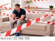 Купить «Young man feeling bored at home in self-isolation concept», фото № 33760105, снято 1 апреля 2020 г. (c) Elnur / Фотобанк Лори