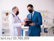 Купить «Young businessman meeting with old doctor», фото № 33760309, снято 4 февраля 2020 г. (c) Elnur / Фотобанк Лори