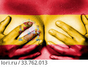 Купить «Sweaty upper part of female body, hands covering breasts, flag of Spain», фото № 33762013, снято 5 июня 2020 г. (c) age Fotostock / Фотобанк Лори