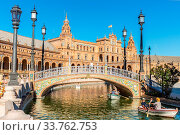 Купить «Seville, Spain, Jun 4: Tourists visiting The Plaza de Espana on Jun 4, 2014.This is a plaza located in the Parque de Maria Luisa built in 1928 for the Ibero-American Exposition of 1929.», фото № 33762753, снято 4 июня 2014 г. (c) age Fotostock / Фотобанк Лори
