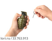 Купить «Hand pulls a check from a grenade isolated on white background», фото № 33763913, снято 10 июля 2020 г. (c) easy Fotostock / Фотобанк Лори