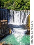 Купить «Красивый водопад на реке Псырцха. Водосброс на гидроэлектростанции», фото № 33769377, снято 19 июня 2018 г. (c) Евгений Ткачёв / Фотобанк Лори
