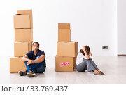 Купить «Young pair and many boxes in divorce settlement concept», фото № 33769437, снято 3 сентября 2019 г. (c) Elnur / Фотобанк Лори