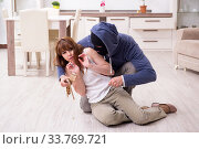 Gangster and young woman in robbery concept. Стоковое фото, фотограф Elnur / Фотобанк Лори