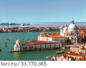 Panoramic top view on Venice, the Basilica Santa Maria della Salute and San Giorgio Maggiore cathedral from the bell tower of St. Mark's Cathedral, Italy (2017 год). Стоковое фото, фотограф Наталья Волкова / Фотобанк Лори