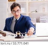 Купить «Young lawyer playing chess to train his court strategy and tacti», фото № 33771041, снято 31 июля 2018 г. (c) Elnur / Фотобанк Лори